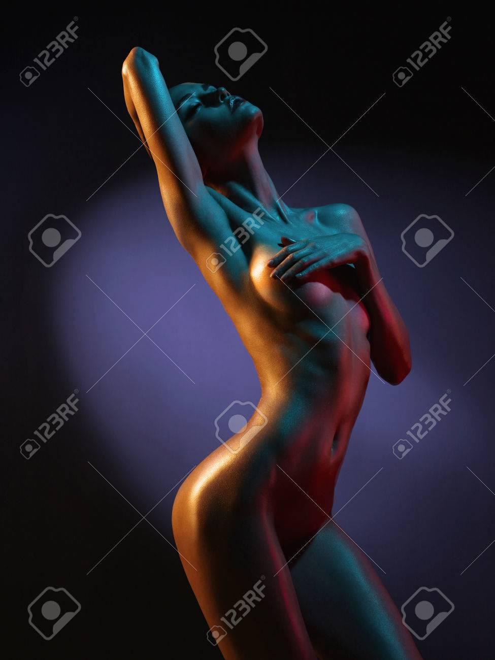 fashion art photo of elegant nude model in the light colored spotlights Standard-Bild - 52039951