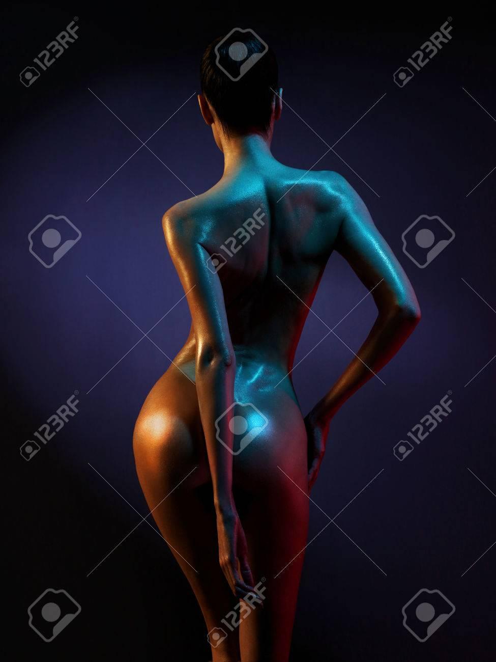 fashion art photo of elegant nude model in the light colored spotlights Standard-Bild - 52039479