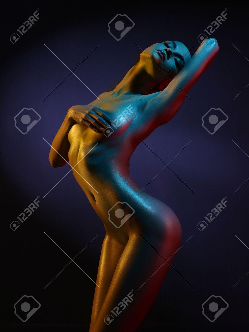 fashion art photo of elegant nude model in the light colored spotlights Standard-Bild - 54751940