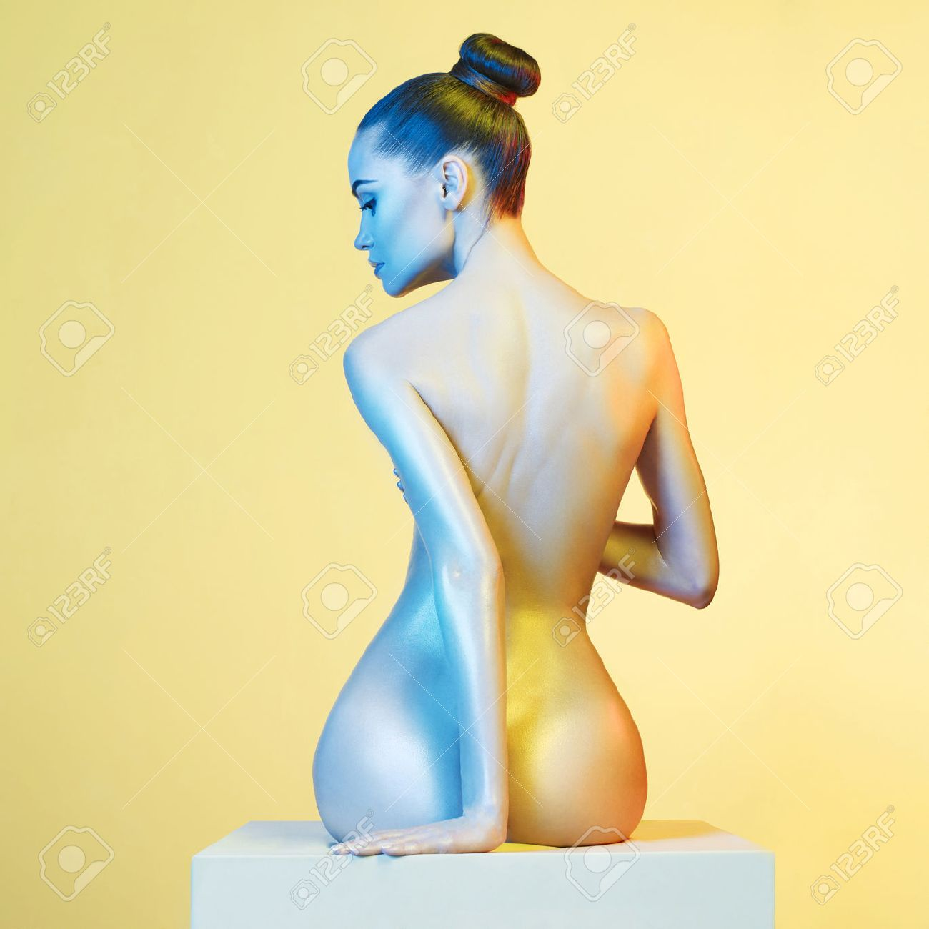 Fashion art photo of elegant nude model in the light colored spotlights Standard-Bild - 54667870