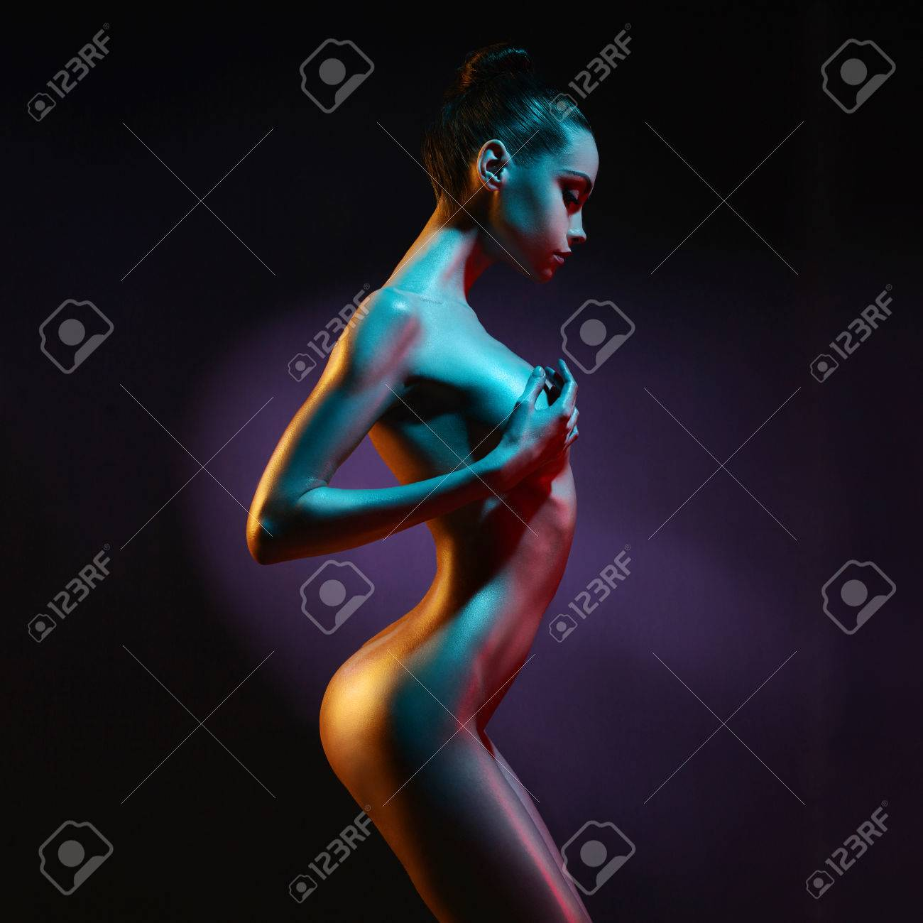 fashion art photo of elegant nude model in the light colored spotlights Standard-Bild - 55048656