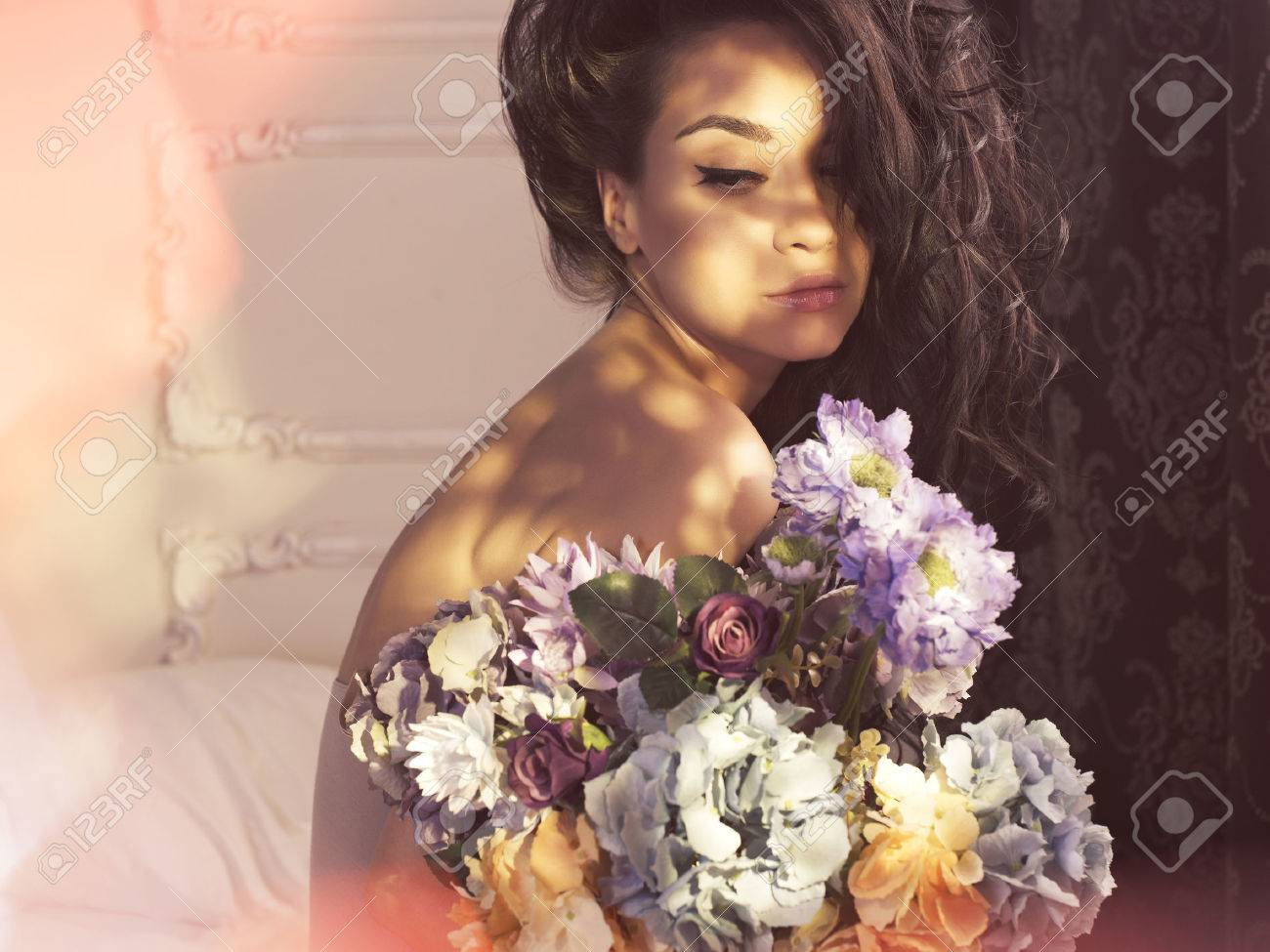 Fashion art photo of beautiful lady with flowers home interior fashion art photo of beautiful lady with flowers home interior morning stock photo dhlflorist Gallery