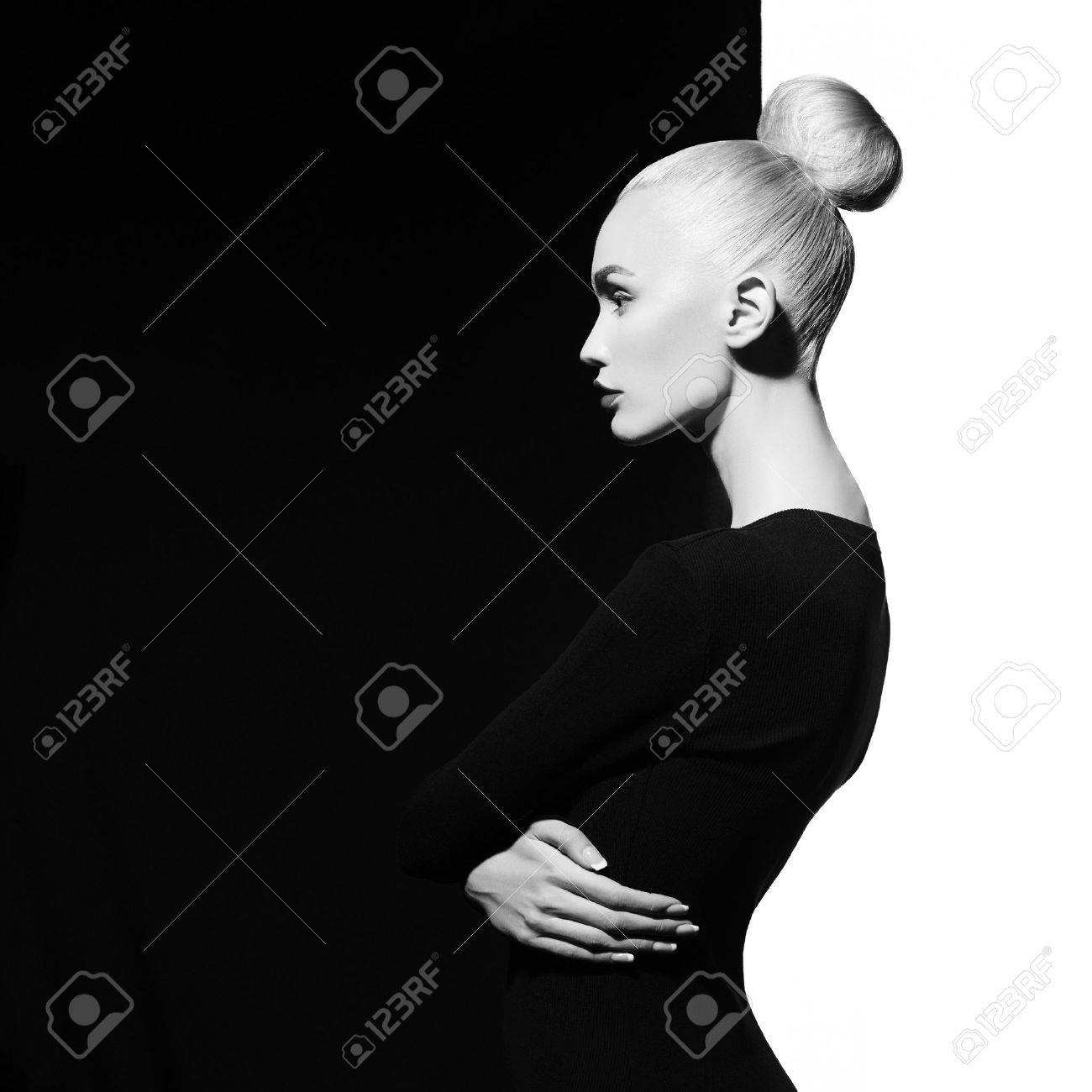 Fashion art studio portrait of elegant blode in geometric black..