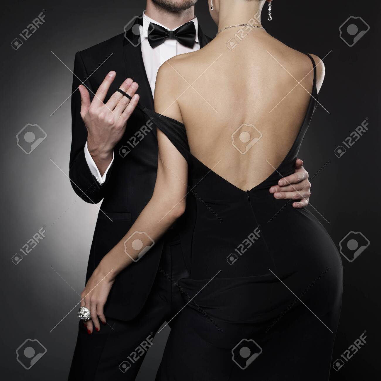 Conceptual photo of elegant couple in the evening suit and dress. dancing lovers pose in photography studio. - 145930784