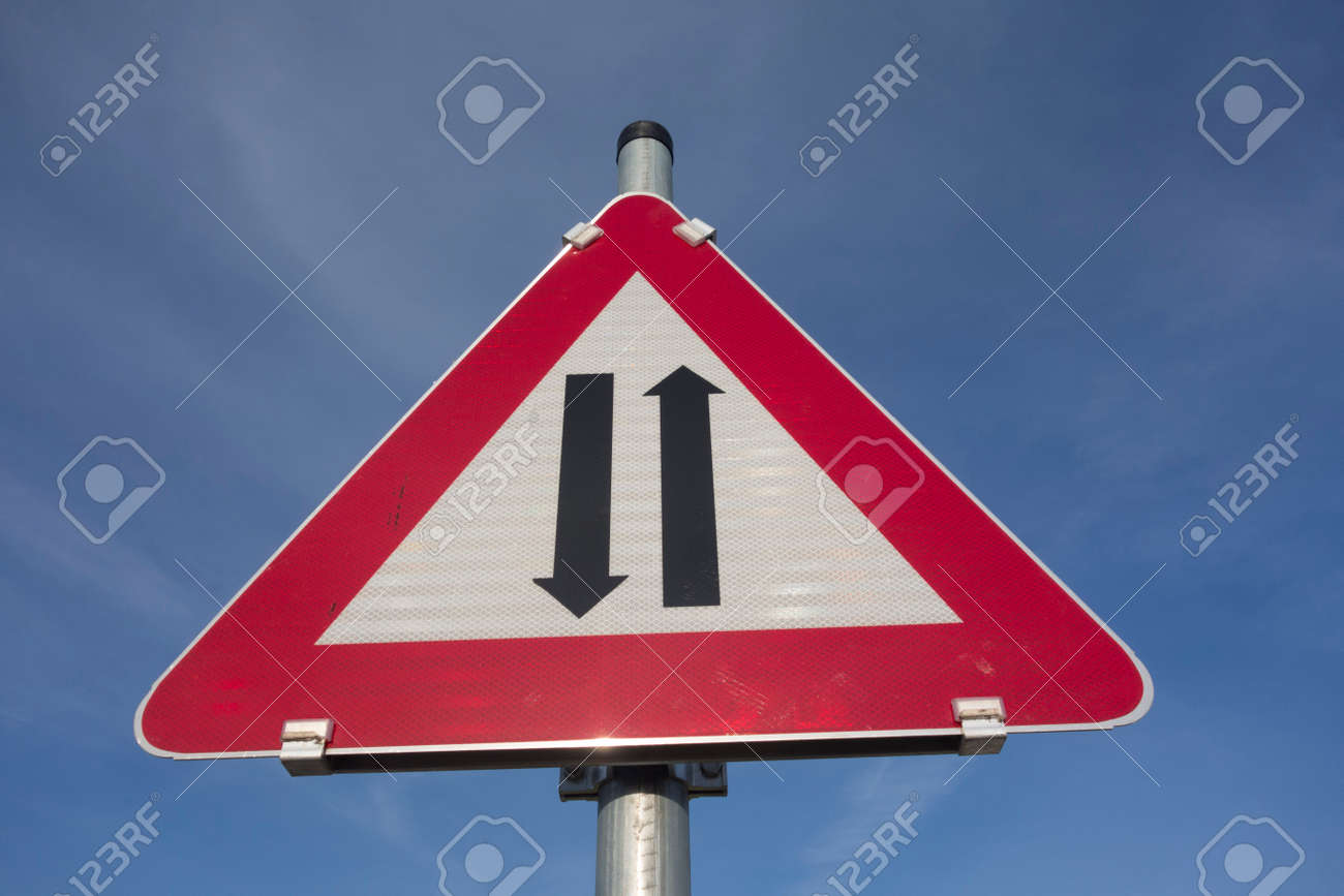 attention two way traffic or oncoming traffic road sign, red triangle as warning notice - 167828402