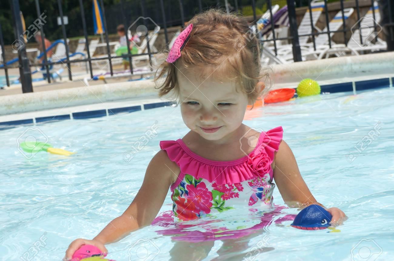 Cute baby girl is having fun in the pool Stock Photo - 21052006