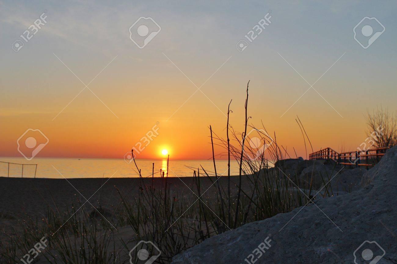 Michigan sanilac county lexington - Stock Photo Sunrise Over The Endless Horizon Of The Great Lakes Sanilac County Park Lexington Michigan