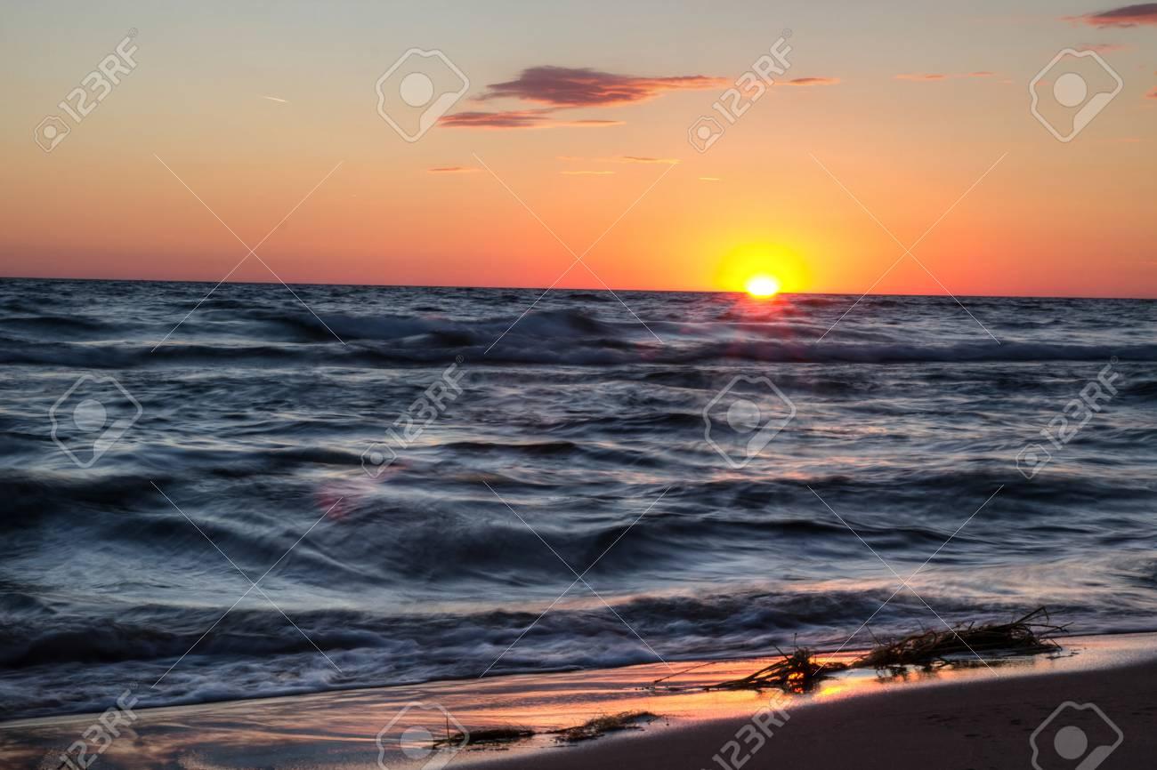 Sunset Beach Background  Sunset sky and waves crashing on the