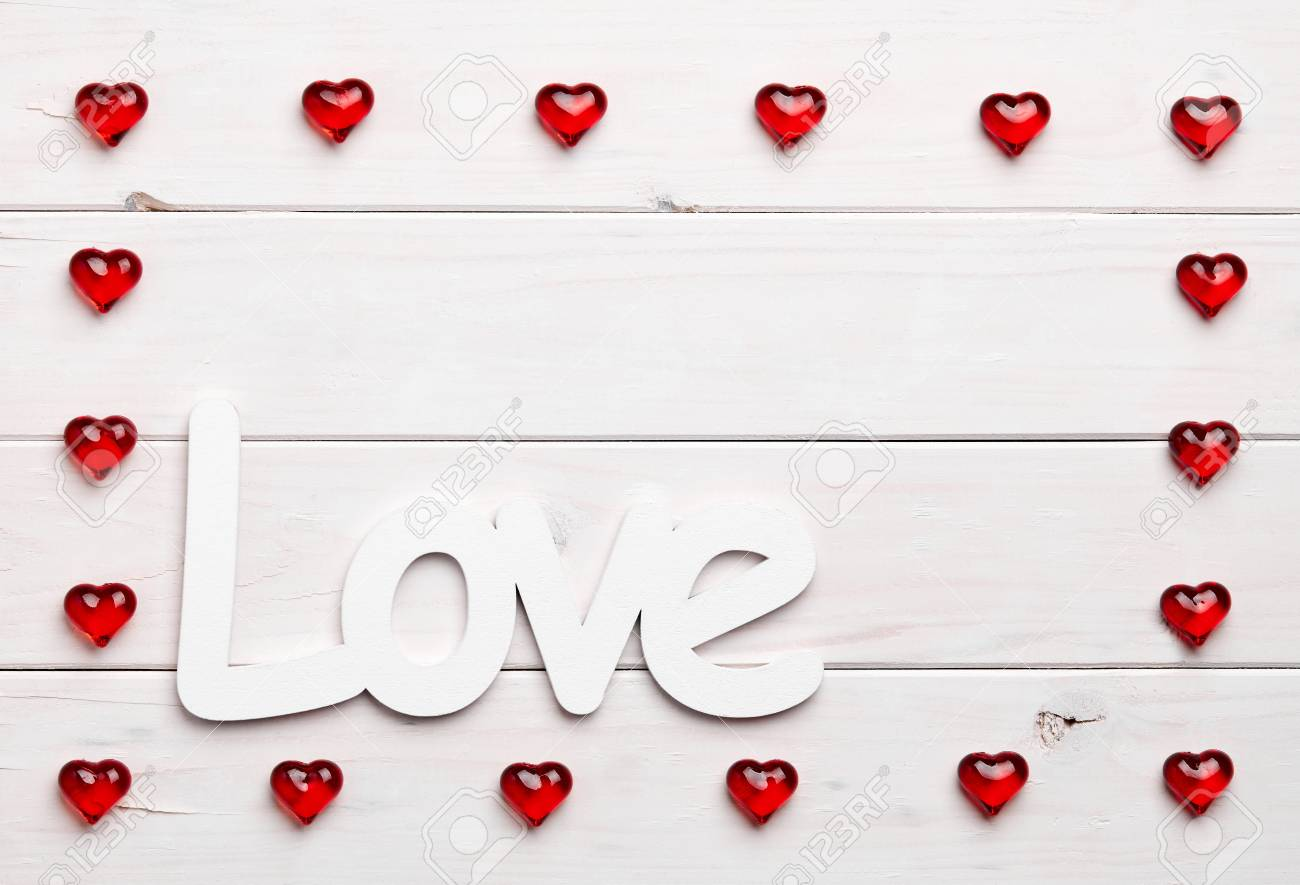 Texture Of A Red Heart Shaped Figures Into Frame With LOVE Phrase ...