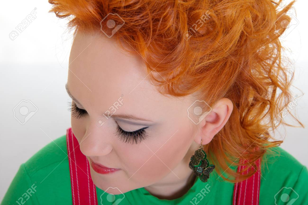 Closeup portrait of a young woman with red hair and glamour make-up Stock Photo - 16715483
