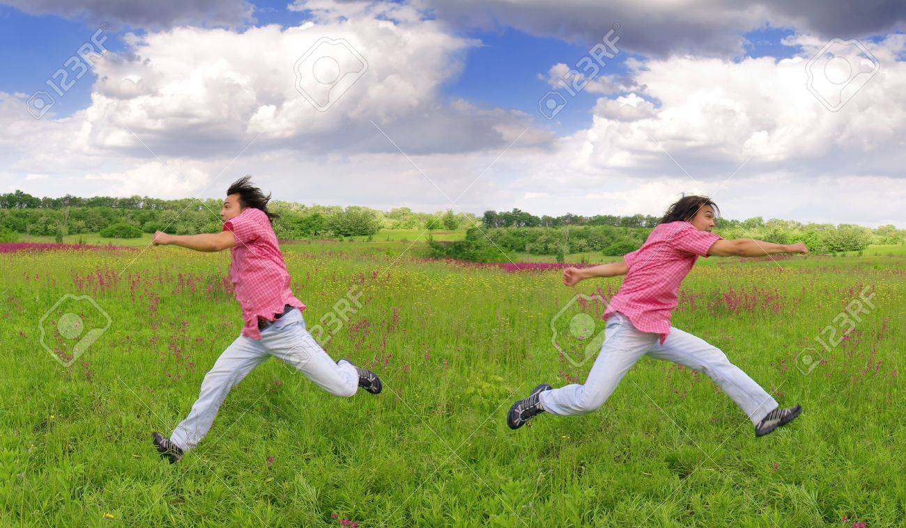 Young men running away from something on grass Stock Photo - 17045902