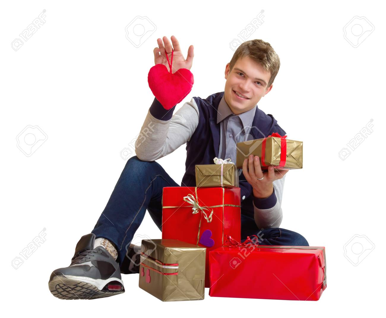 Valentines Man /  Teenager holding heart and gifts isolated on white background Stock Photo - 17370184