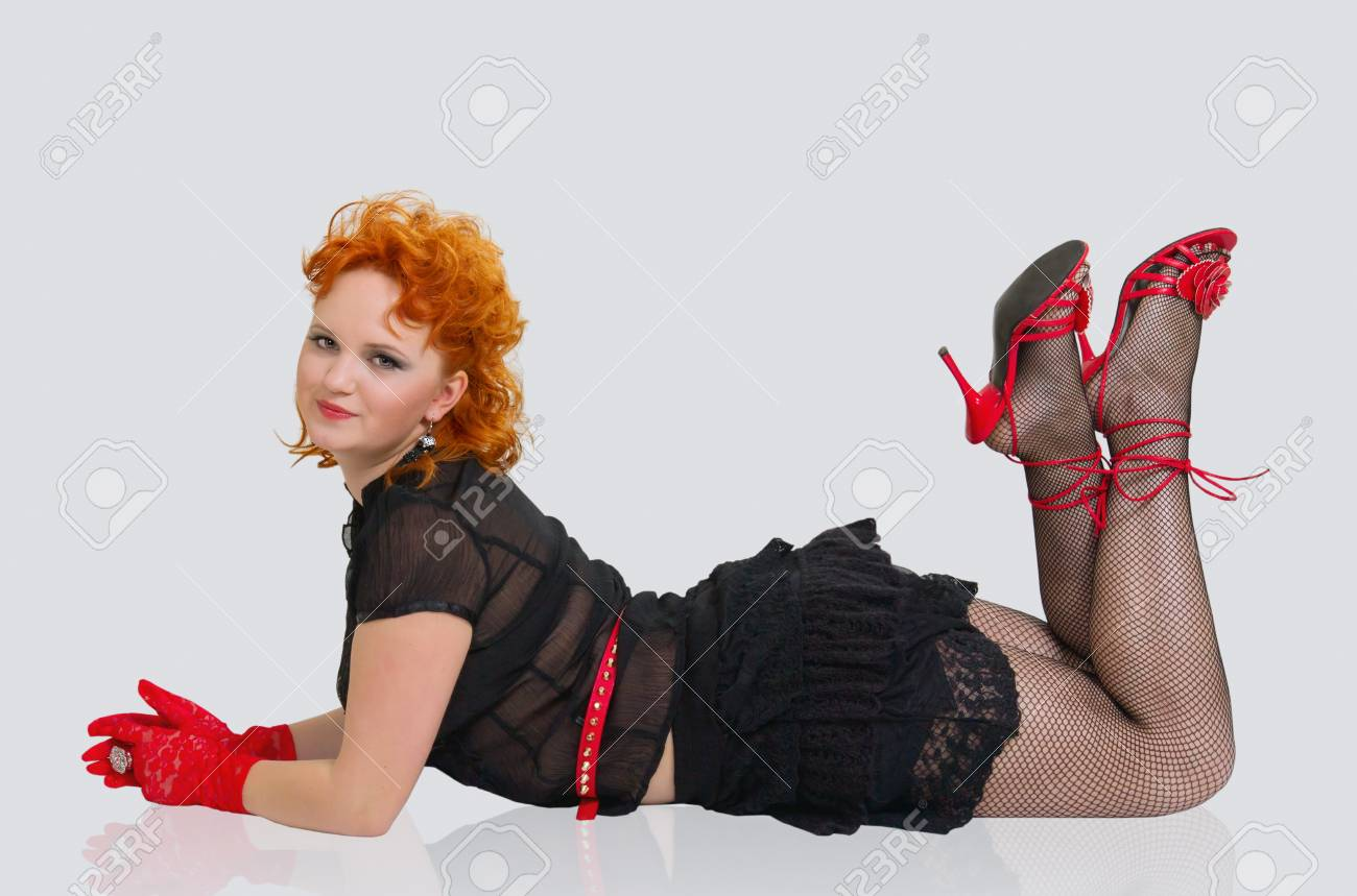 Beautiful girl with red hairs lying on the floor Stock Photo - 17958335