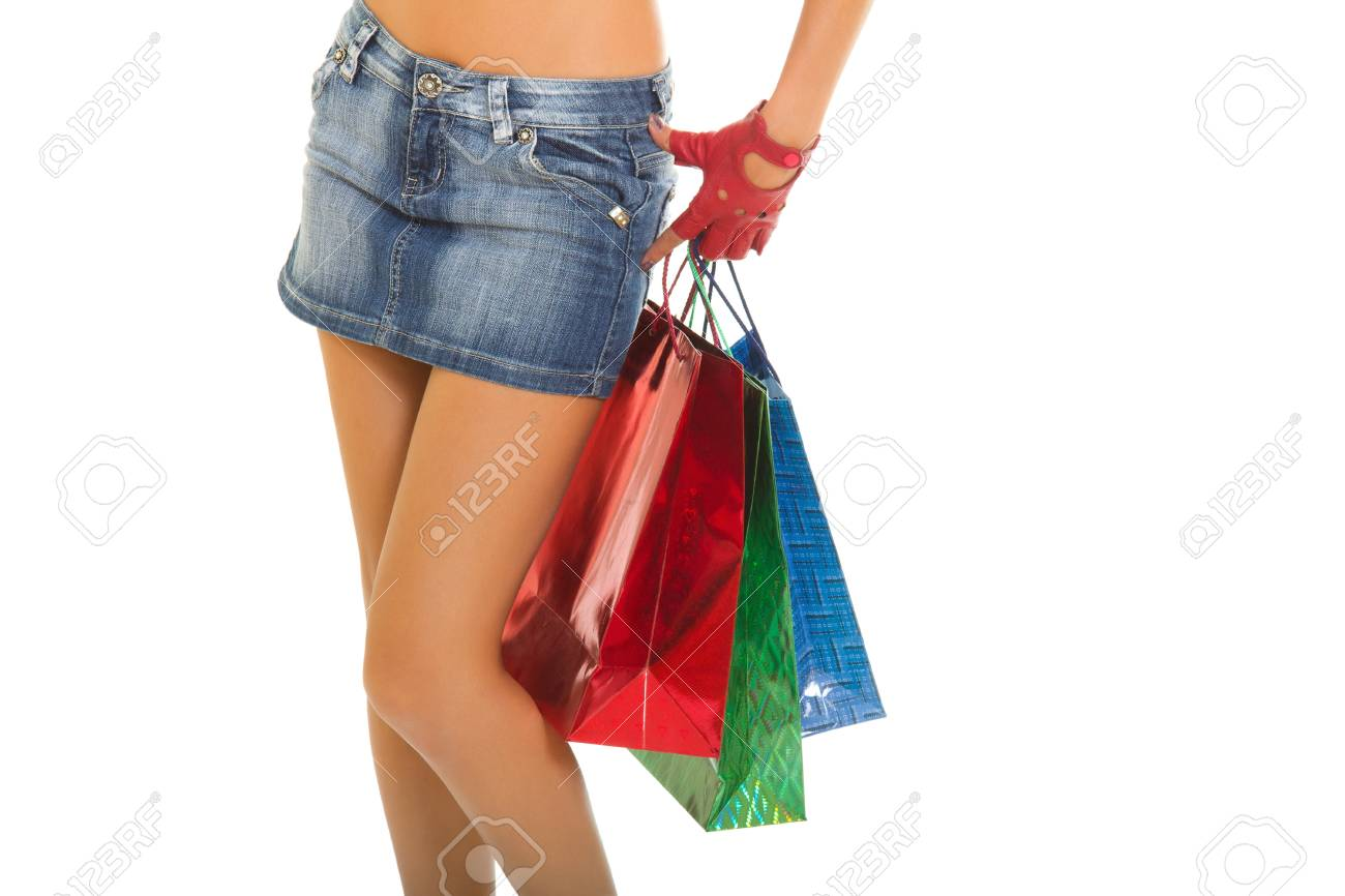 Close up of sexy woman legs and body with shopping bags isolated on a white Stock Photo - 18936524