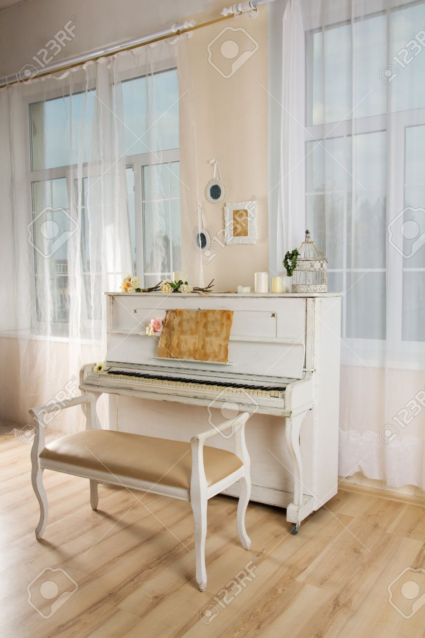 Old White Piano And Chair In A Living Room Stock Photo, Picture And ...