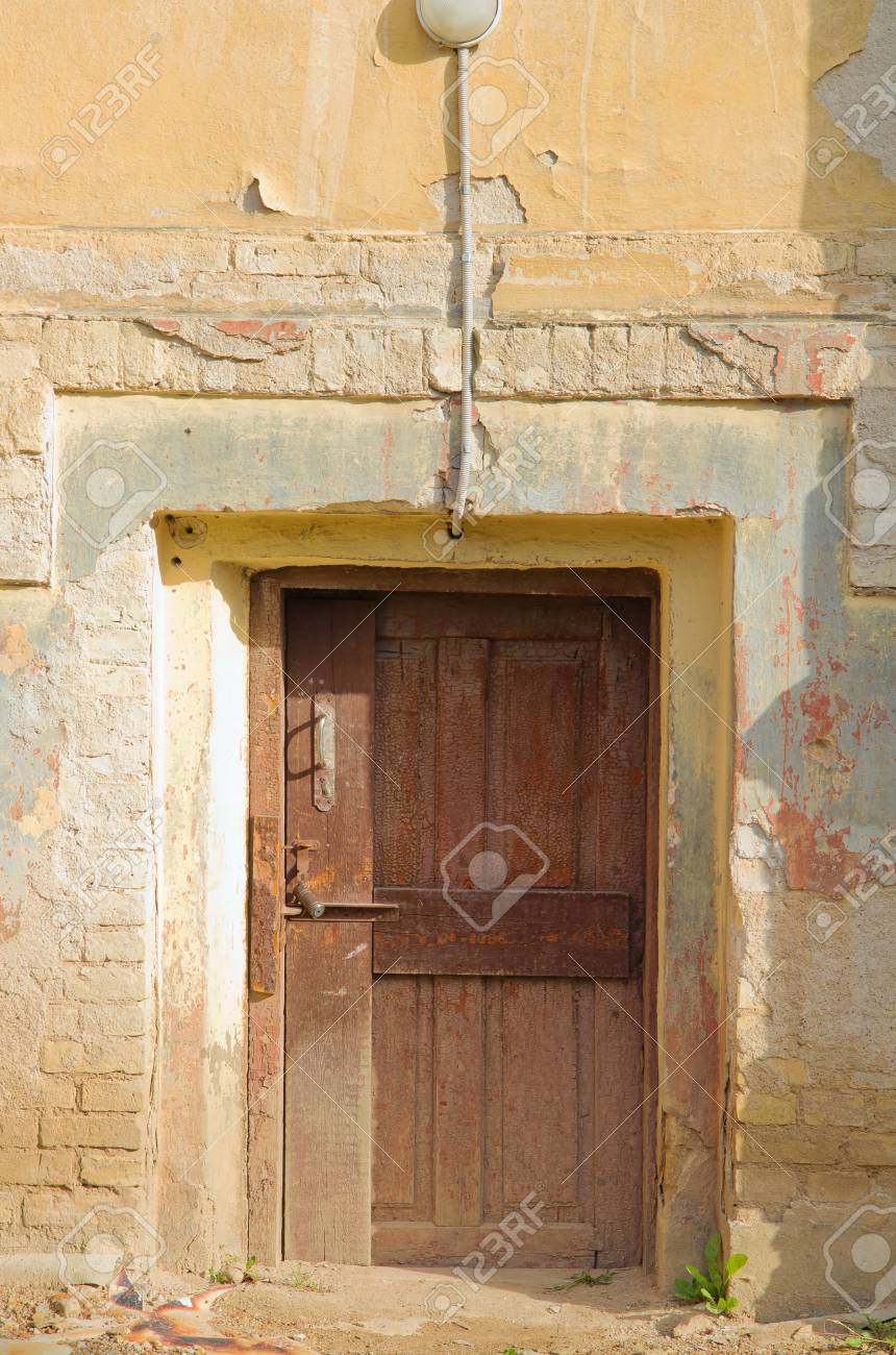 Old Wooden Door Frame And Yellow Wall Stock Photo Picture And