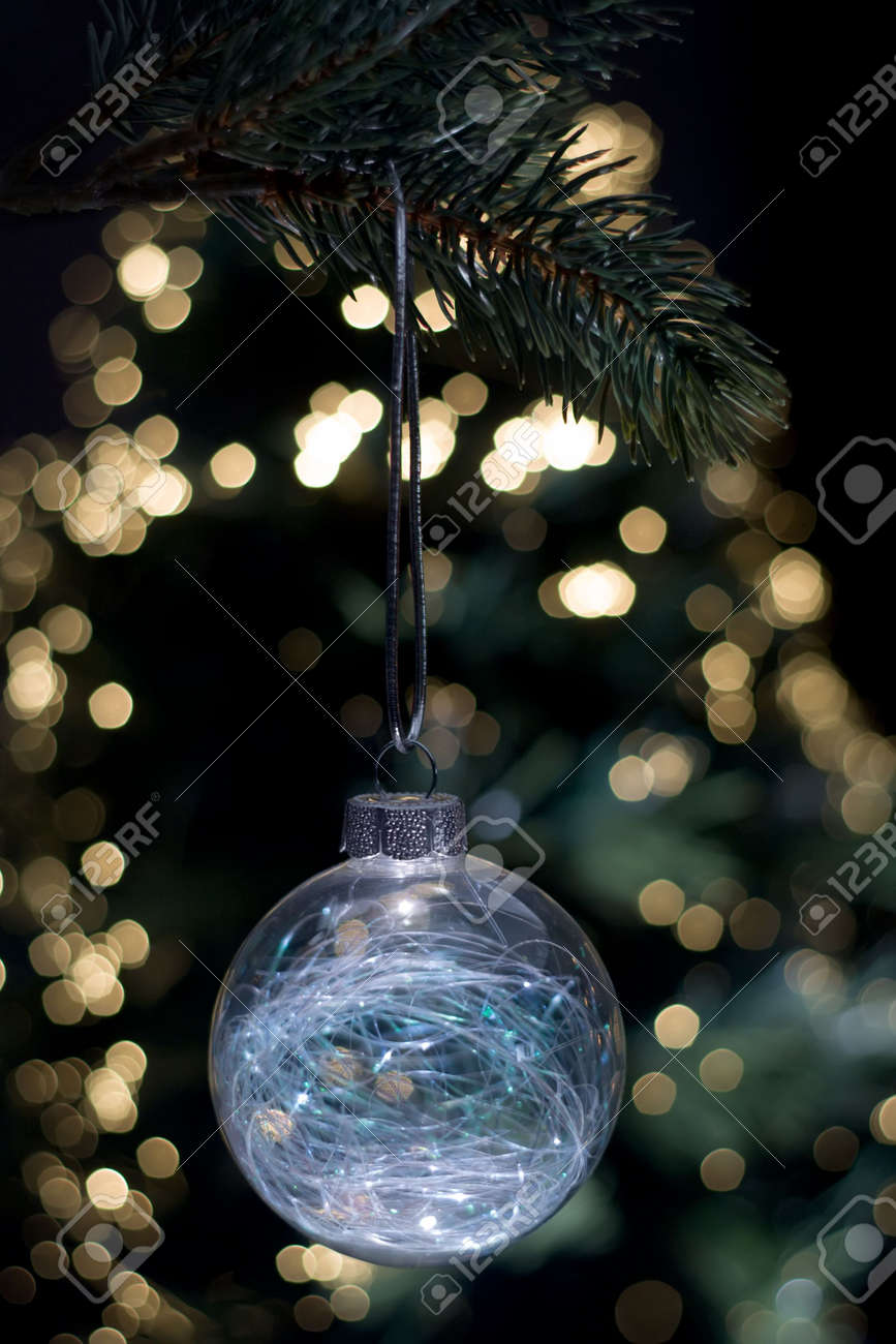 Clear Christmas Ornaments.Clear Glass Christmas Ornament Hanging From A Tree With A Background