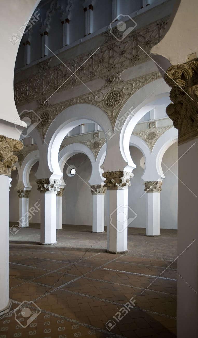 Mudejar arches inside the Santa Maria la Blanca synagogue in Toledo, Spain.  Dates to the 13th century. Stock Photo - 2822756