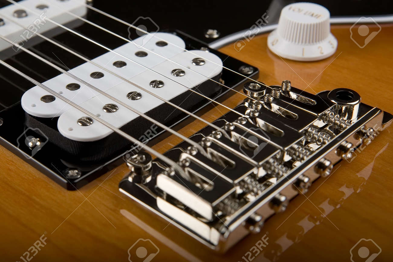 Closeup Of Body Of Electric Guitar With View Of Bridge And Pickups