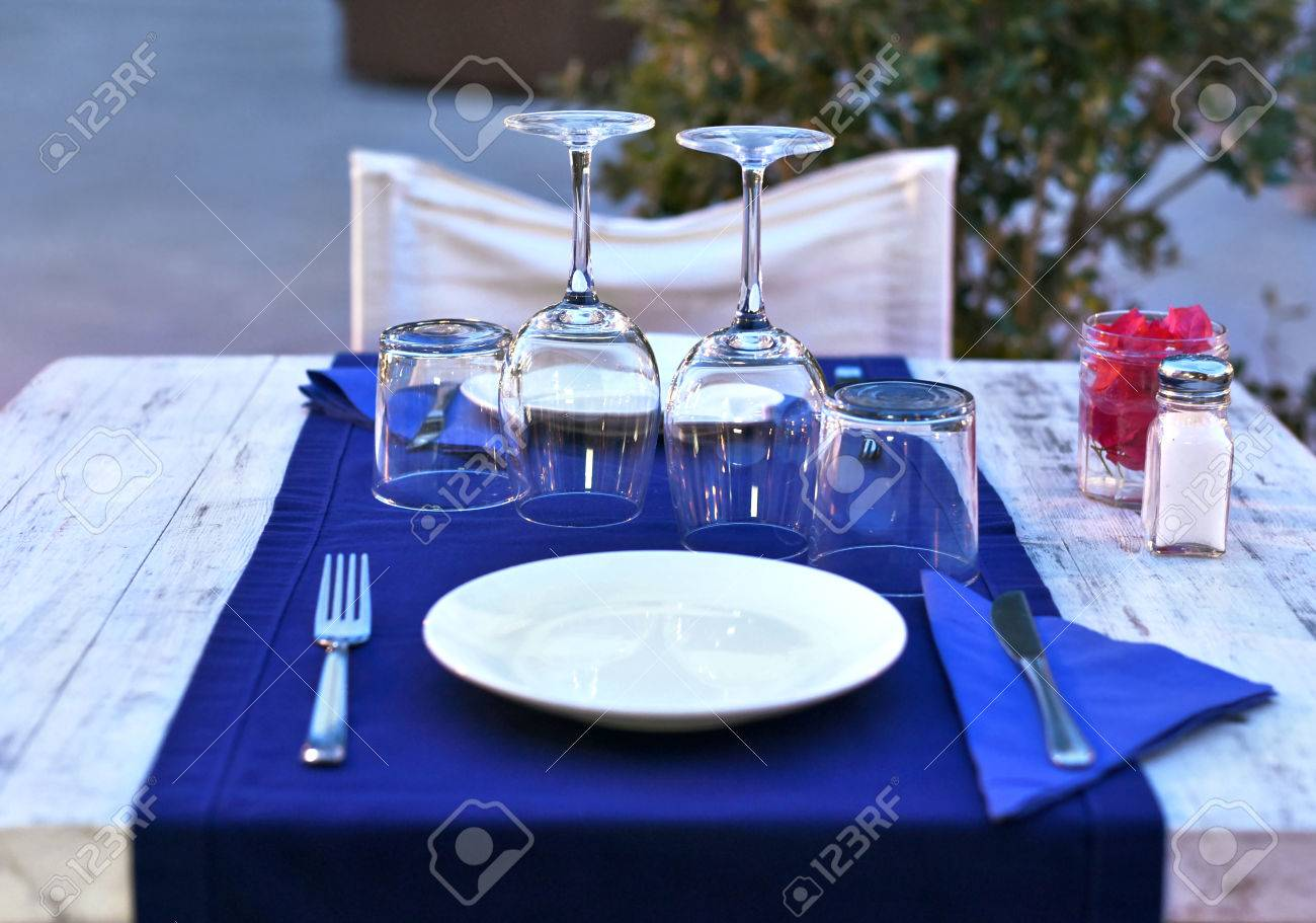 Fancy restaurant table setting - Dinner Table Setting In The Evening Dinner For Two At A Restaurant Stock Photo
