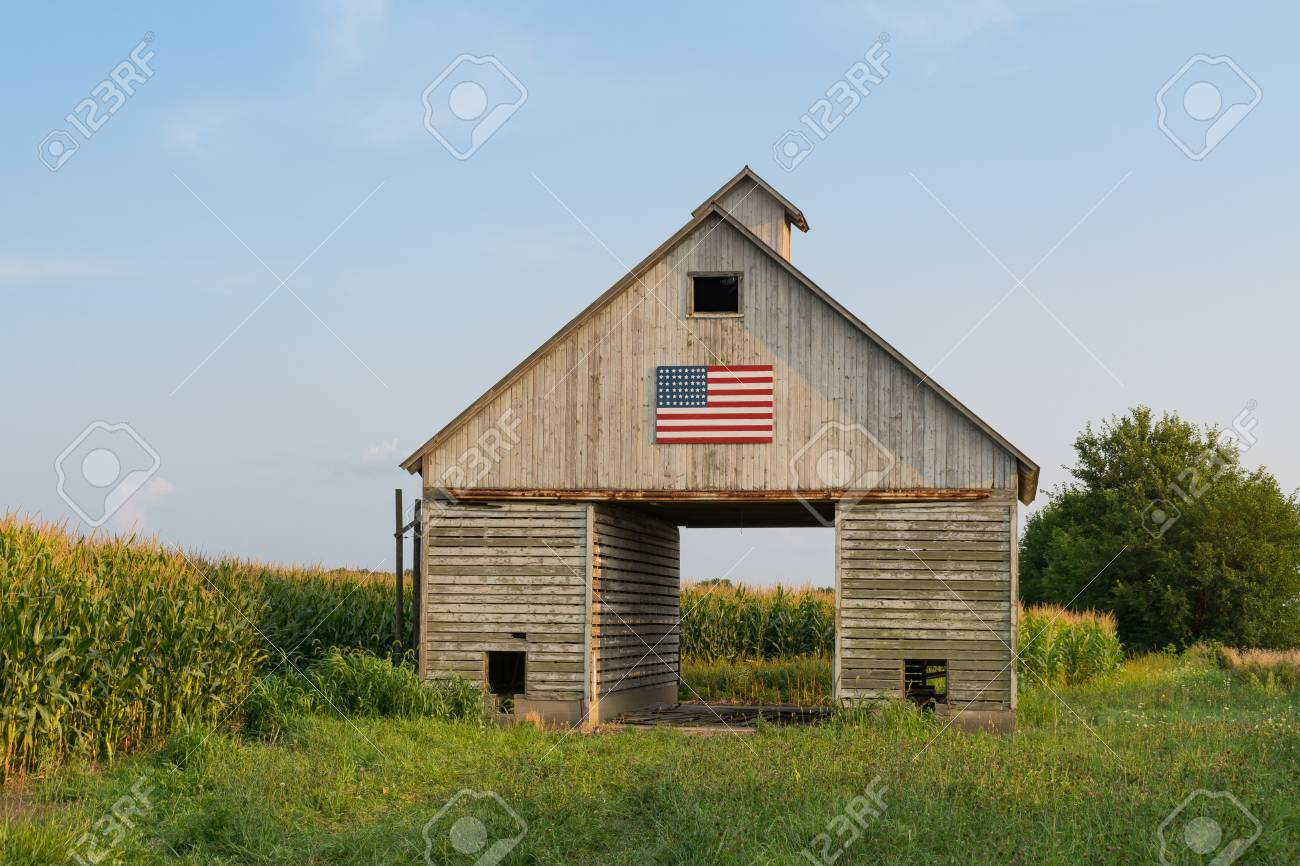 Old rustic barn in the Midwest with painted American flag. LaSalle, Illinois, USA - 115952074