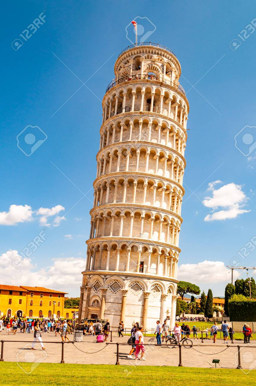 Pisa, Italy - September 03, 2019: The famous leaning Tower of Pisa or La Torre di Pisa at the Cathedral Square, Piazza del Duomo in Pisa, Italy - 133858845