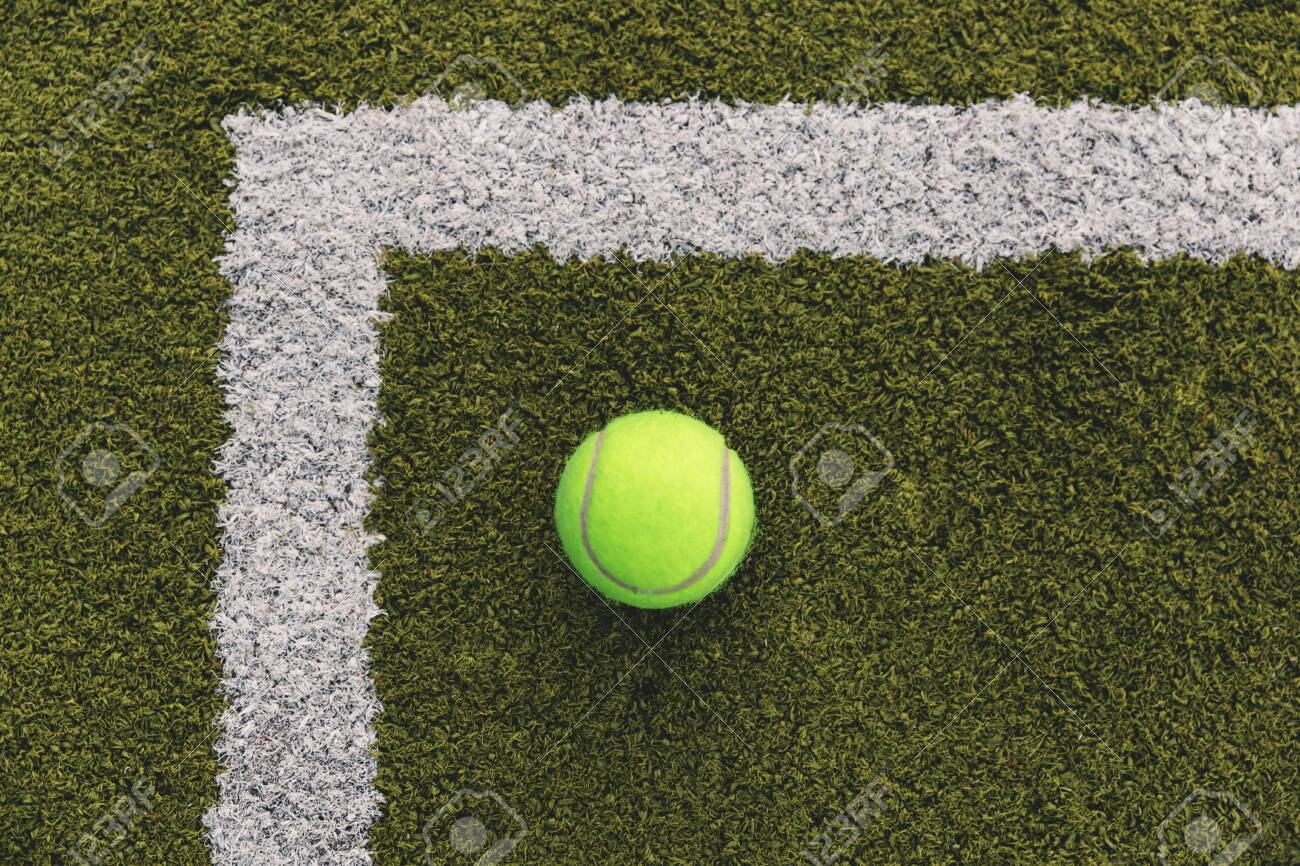 Yellow Tennis Ball On The Tennis Court Stock Photo Picture And Royalty Free Image Image 152461513