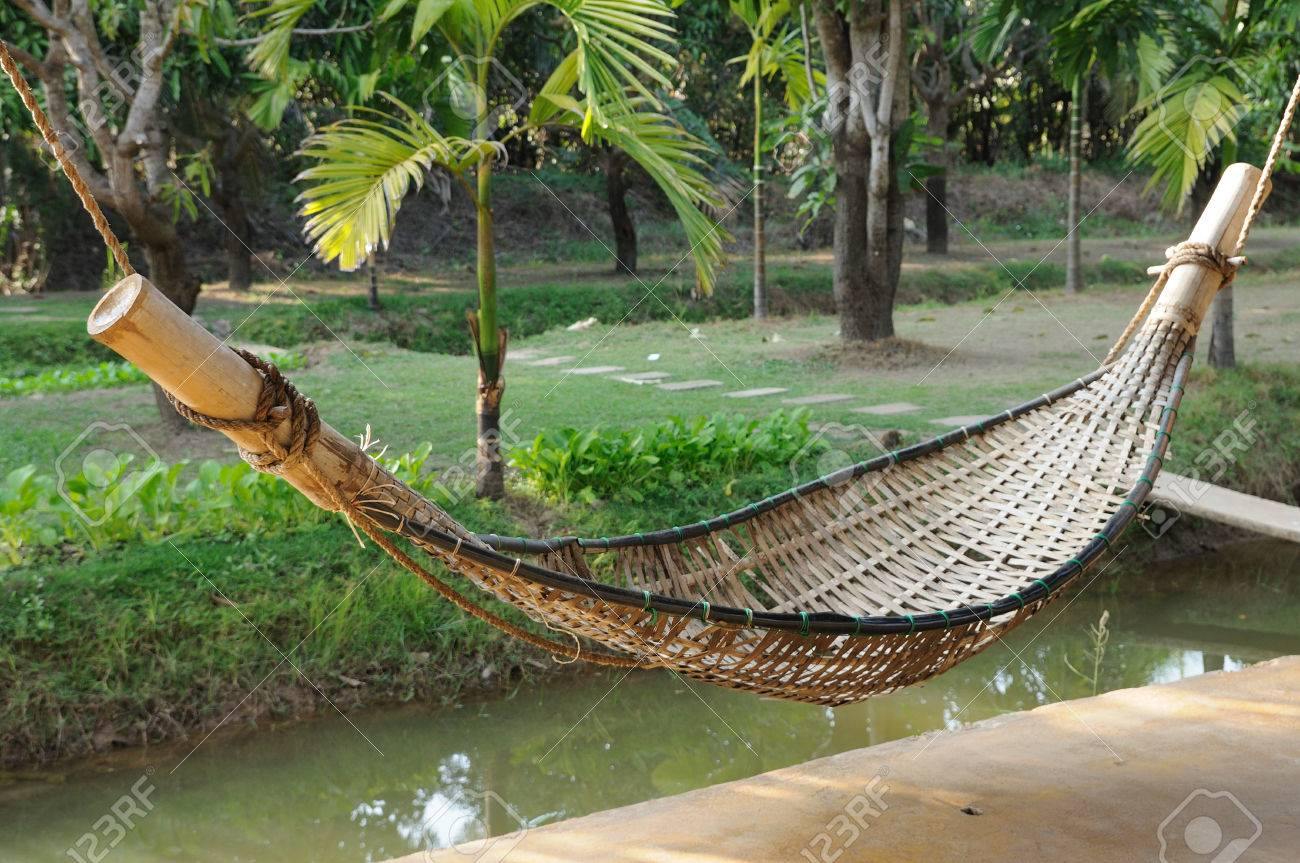 old bamboo hammock hanging in garden stock photo   25565013 old bamboo hammock hanging in garden stock photo picture and      rh   123rf