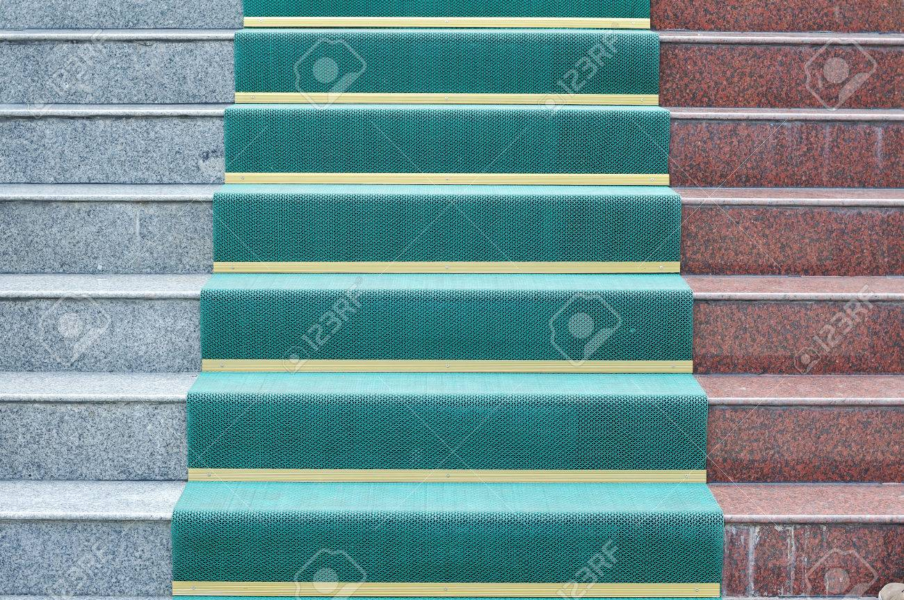 Color marble stairs with green plastic flooring Stock Photo - 28897920