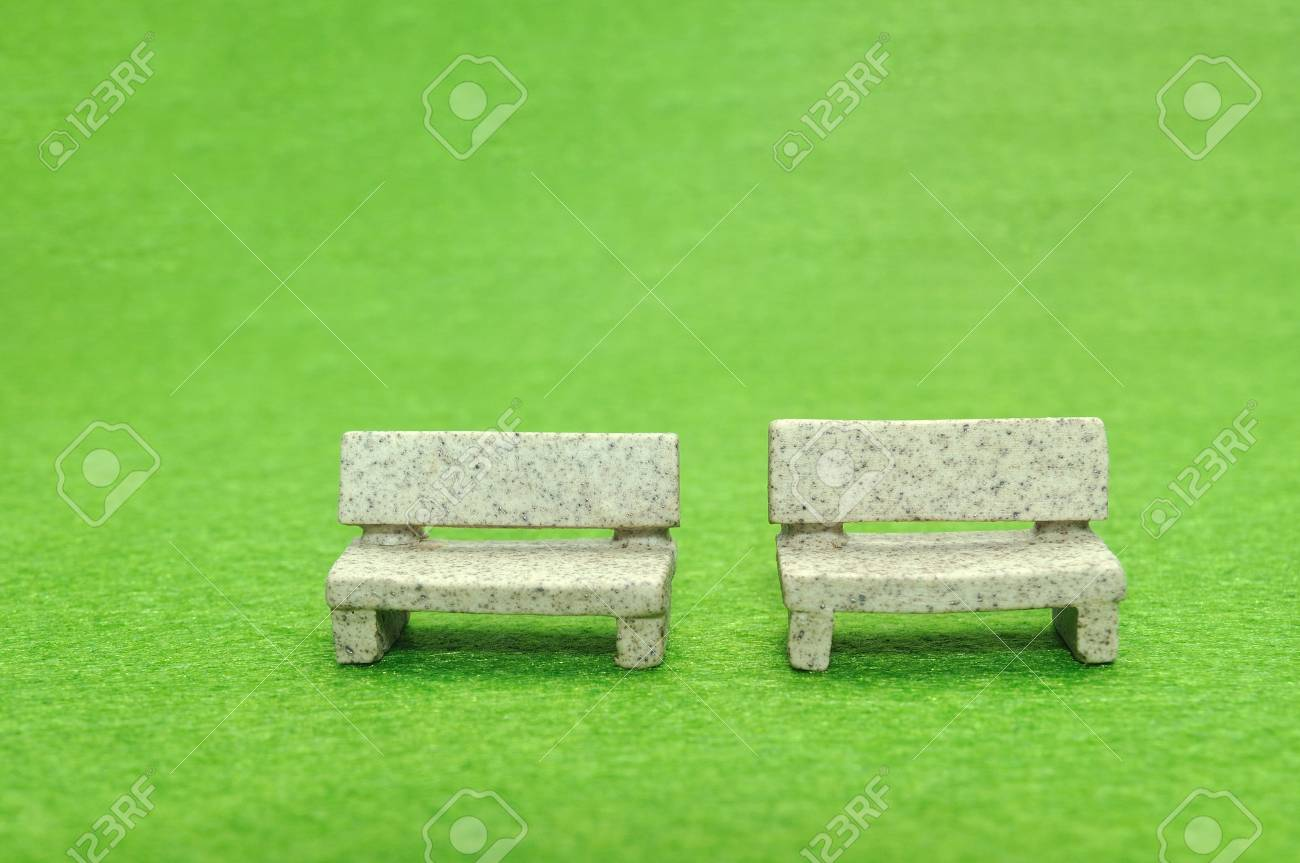 Selective Focus Miniature Stone Bench Set On Green Yard Stock Photo - Stone picnic table set