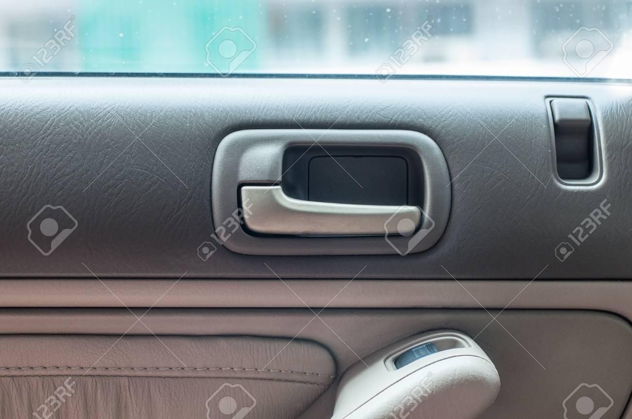 Car Door Open Handle Inside With Luxury Interior Stock Photo