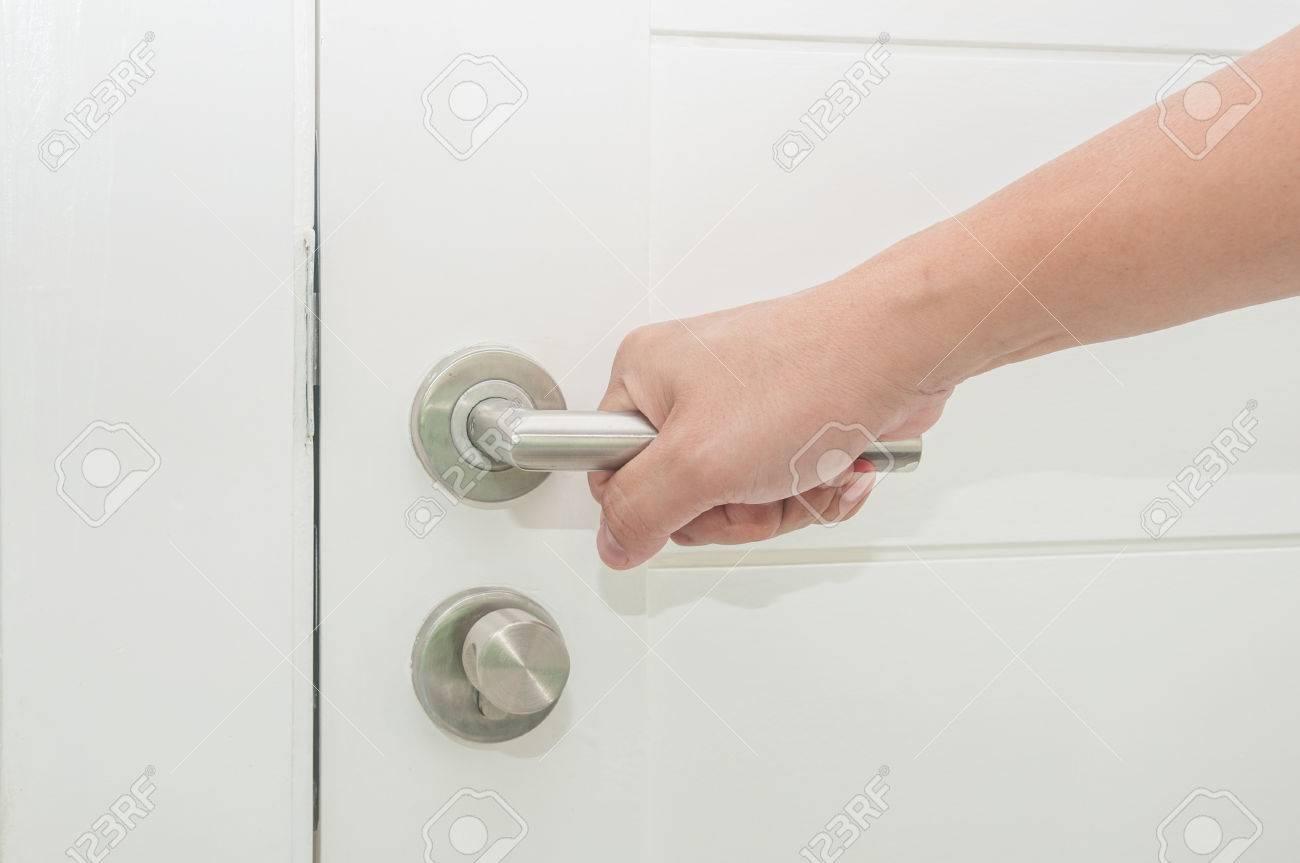 Man Hand Holding Door Element Handle For Open Or Lock The Door. Stock Photo