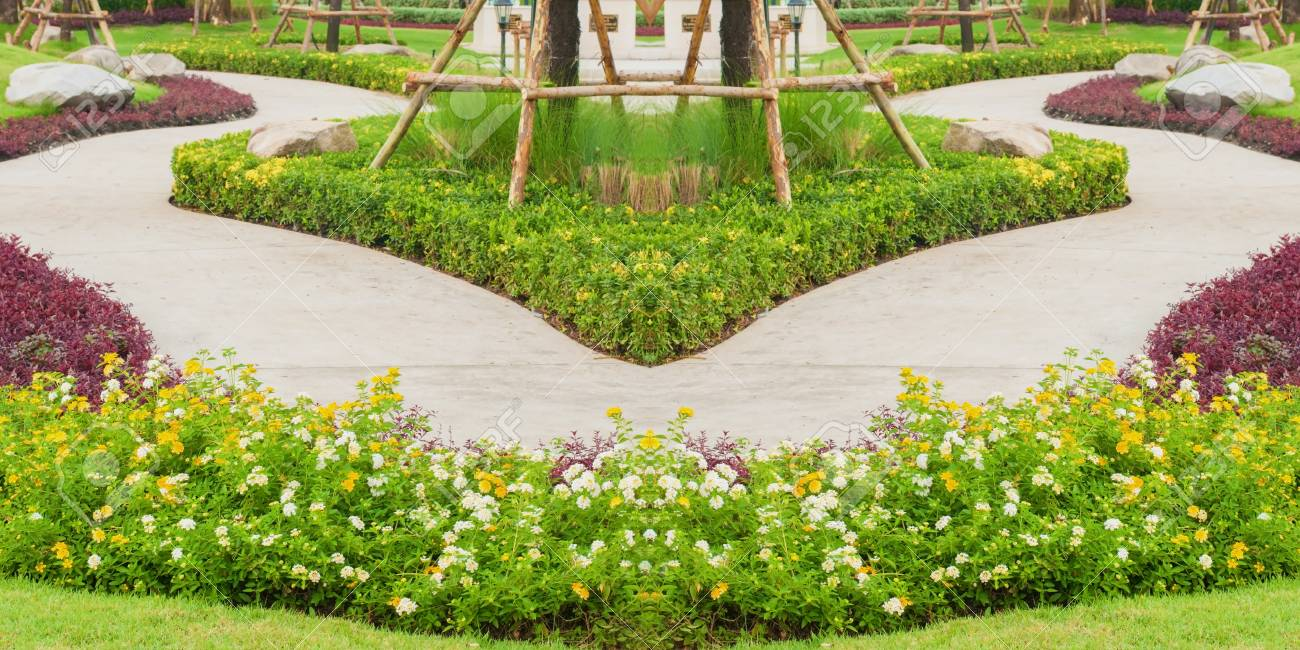Beautiful Flower Park With Curve Walk Way And Many Tree Stock Photo