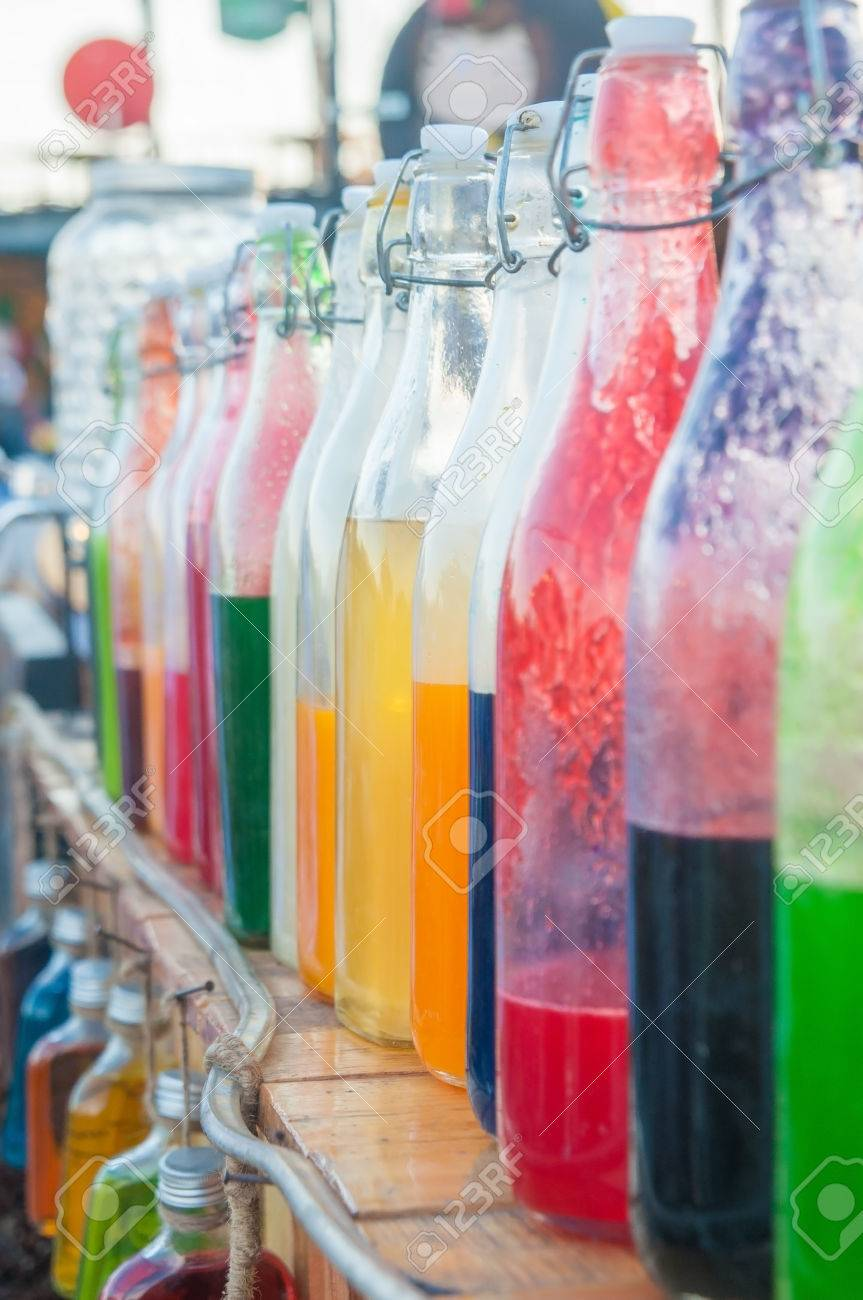 Colorful Syrup In Bottles For House Interiors Stock Photo, Picture ...