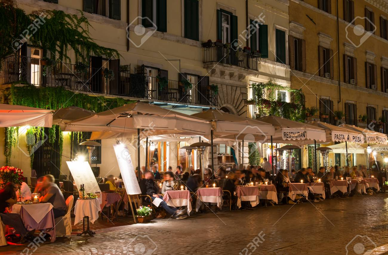 Night View Of Restaurants On Piazza Navona In Rome Italy