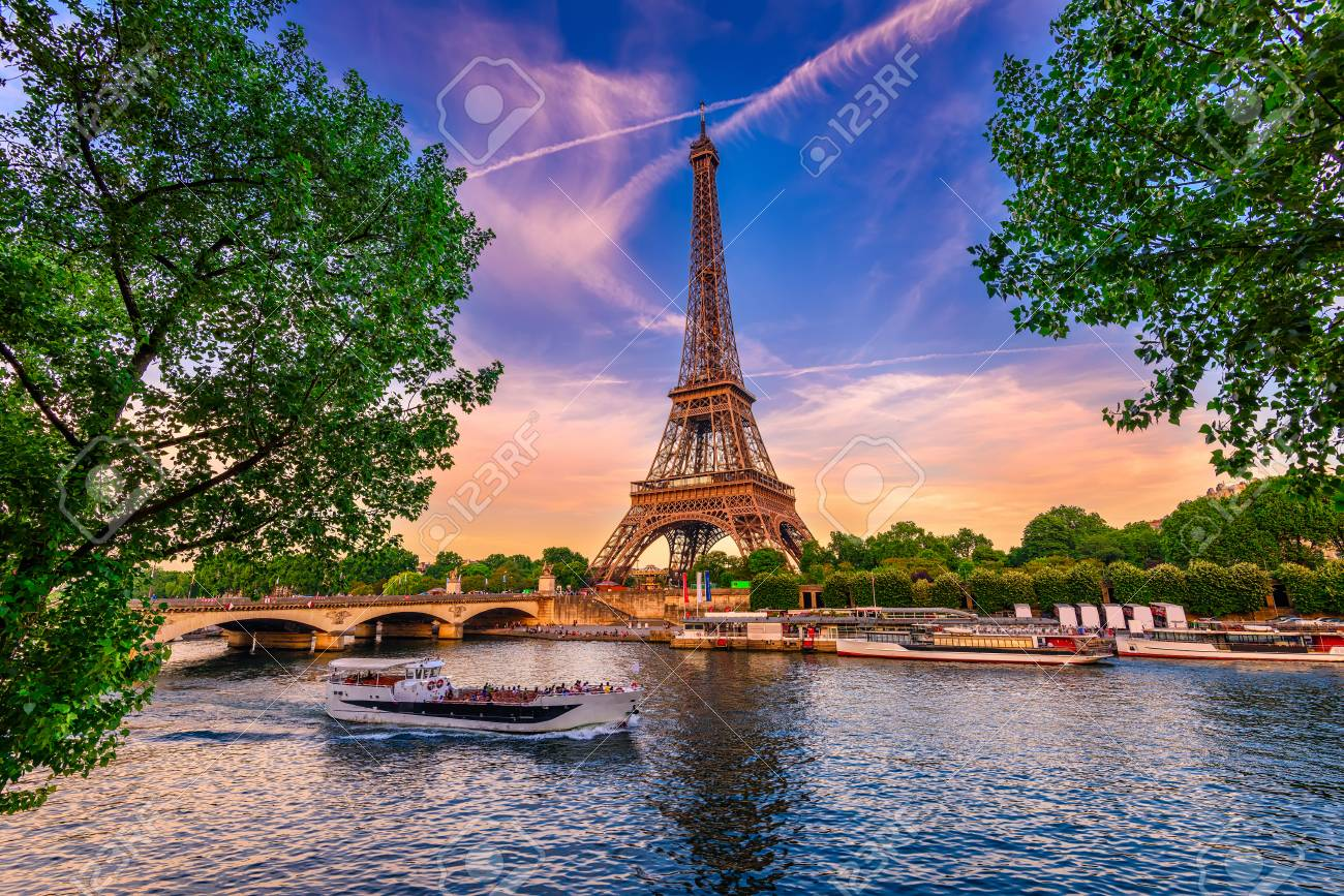 Paris Eiffel Tower and river Seine at sunset in Paris, France. Eiffel Tower is one of the most iconic landmarks of Paris. - 81220886