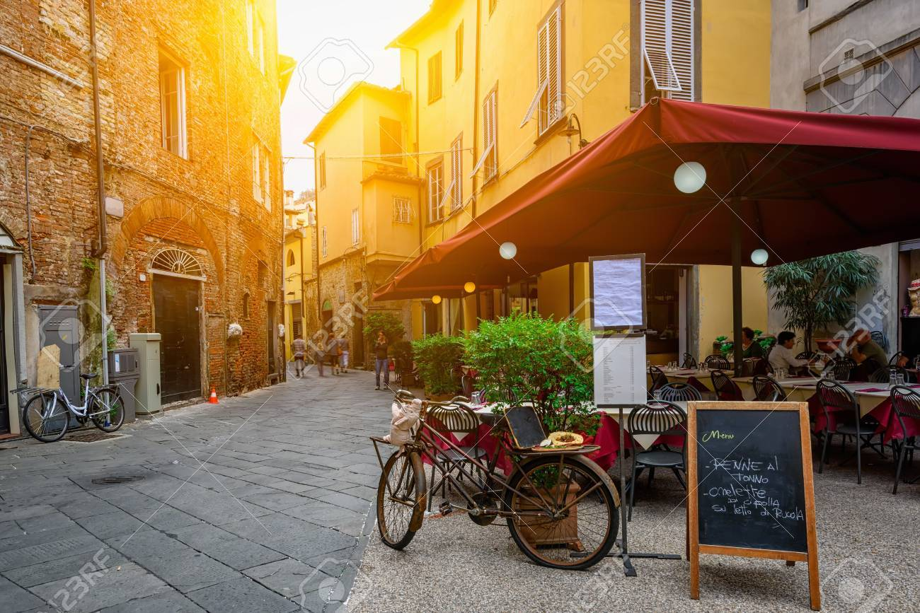 Old cozy street in Lucca, Italy - 89136139