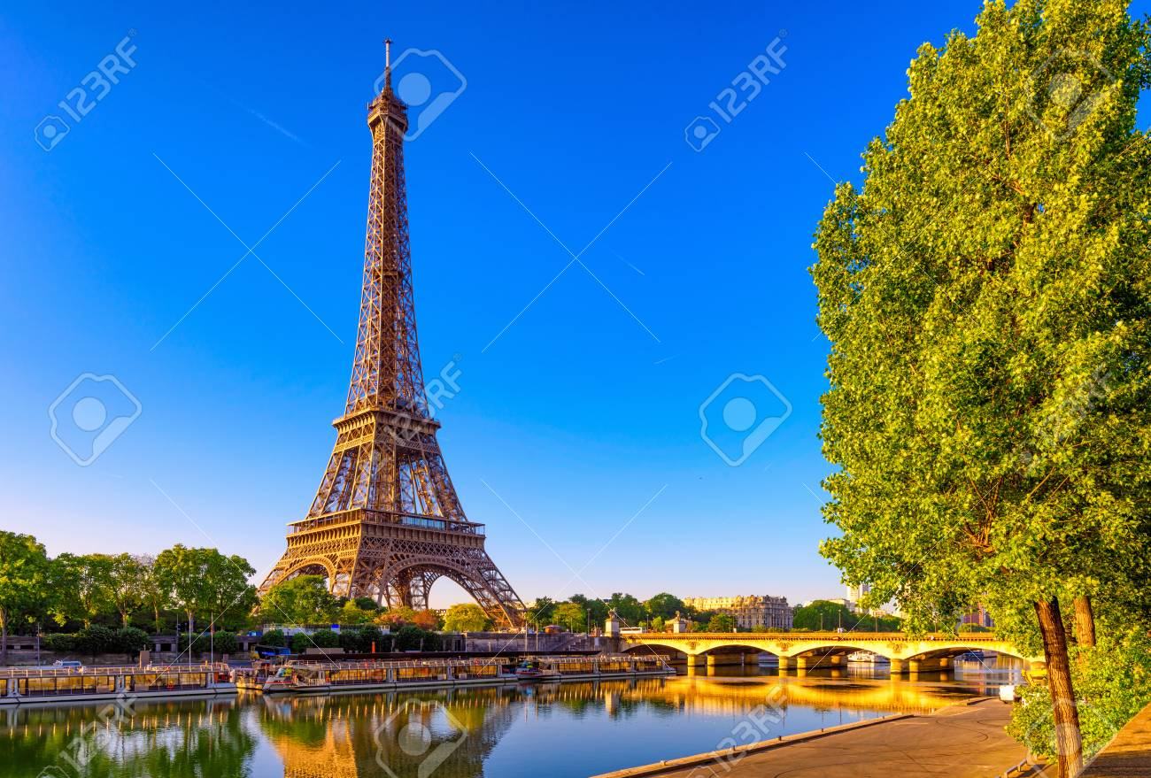 View of Eiffel Tower and river Seine at sunrise in Paris, France. Eiffel Tower is one of the most iconic landmarks of Paris - 105147881