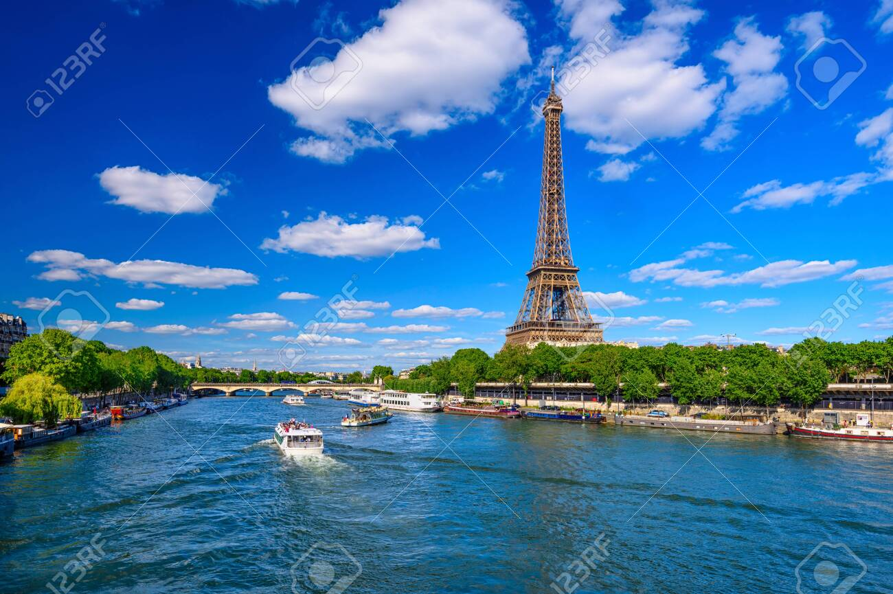 Paris Eiffel Tower and river Seine in Paris, France. Eiffel Tower is one of the most iconic landmarks of Paris. Cityscape of Paris - 135791063