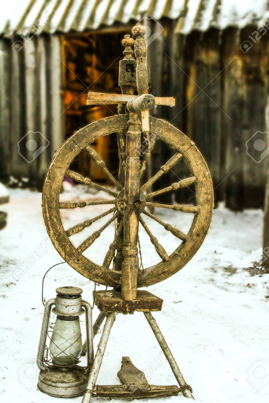 Old Spinning Wheel Which Stands On The Street Next To The Spinning Stock Photo Picture And Royalty Free Image Image 146899668