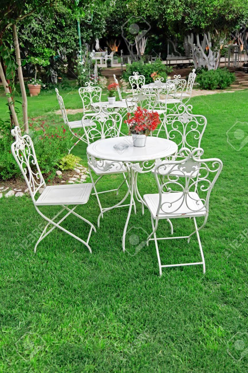 Stock Photo   White Garden Furniture In Beautiful Garden Vintage Garden  Outdoor
