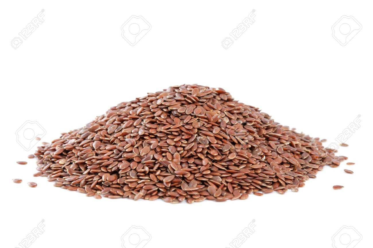 Heap Flax seeds  Linum usitatissimum  isolated on white background  Also called common flax or linseed  Used as an ingredient in paints, fiber and cattle feed, produce a vegetable oil  The plant is also used in medicine Stock Photo - 13493438