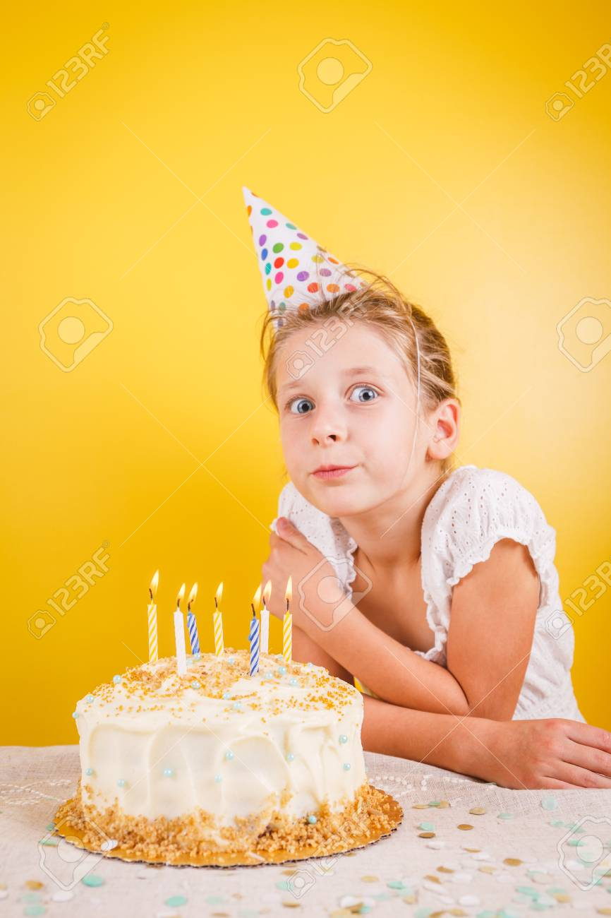 Girl Making A Wish By Birthday Cake Party Celebration Concept Vertical Standard