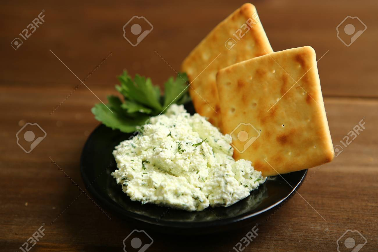 On A Dark Plate A Portion Of Cottage Cheese With Greens Is Decorated Stock Photo Picture And Royalty Free Image Image 95284467