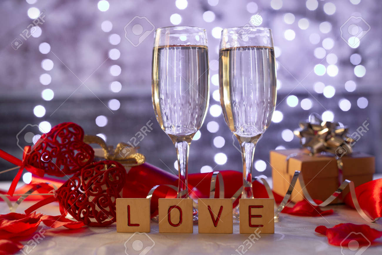 beautiful card with glasses of champagne hearts and a gift box for the feast of Valentine's Day in February - 161212596