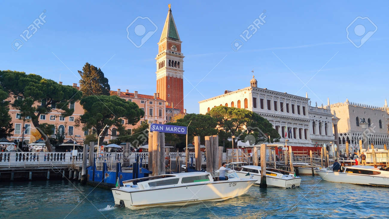 Venice Italy - October 10, 2019. Panorama of a beautiful view of the Grand Canal with houses with a boat in San Marco square. - 161601483