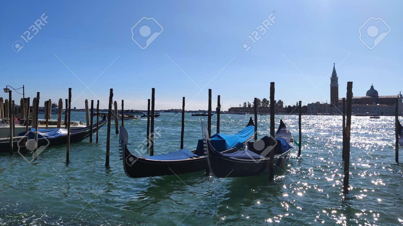 Venice, Italy coastal view of piazza san marco venice italy with gondola boats on the shore - 169323701
