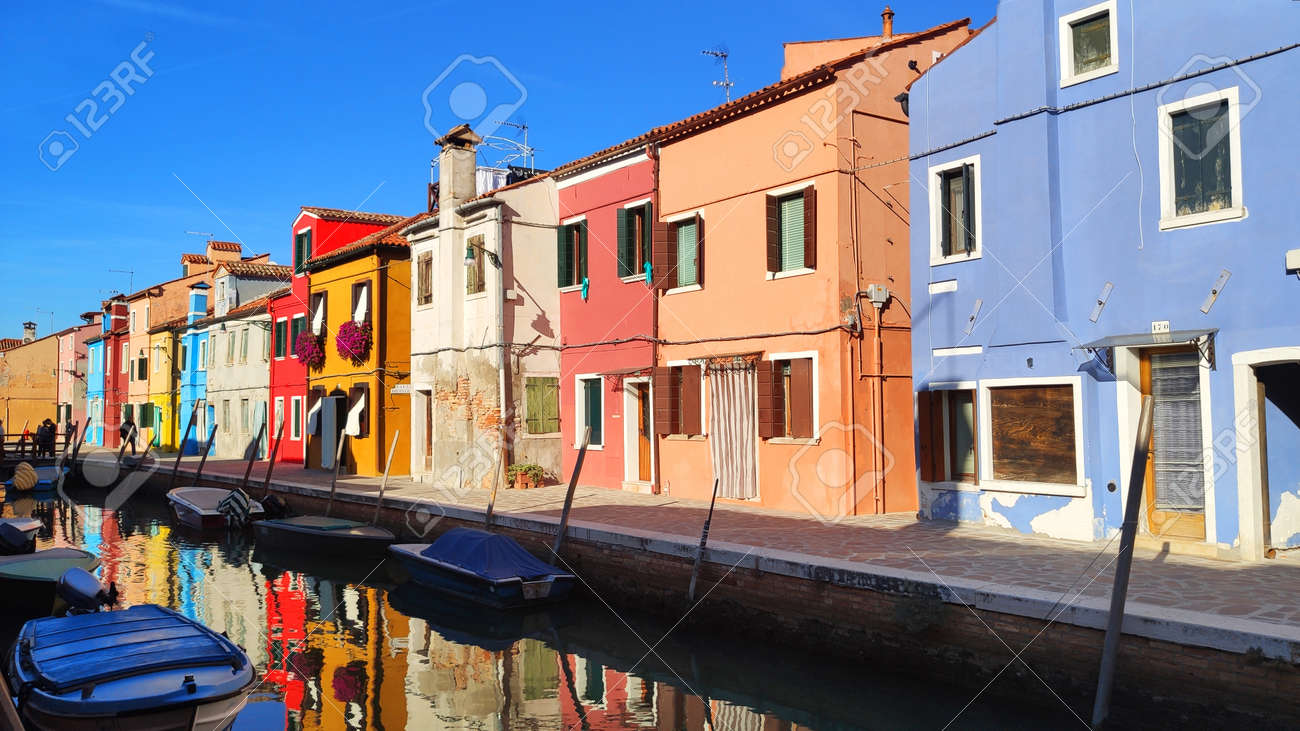 Venice Italy Burano . City view island with colorful houses in with boats - 164623025