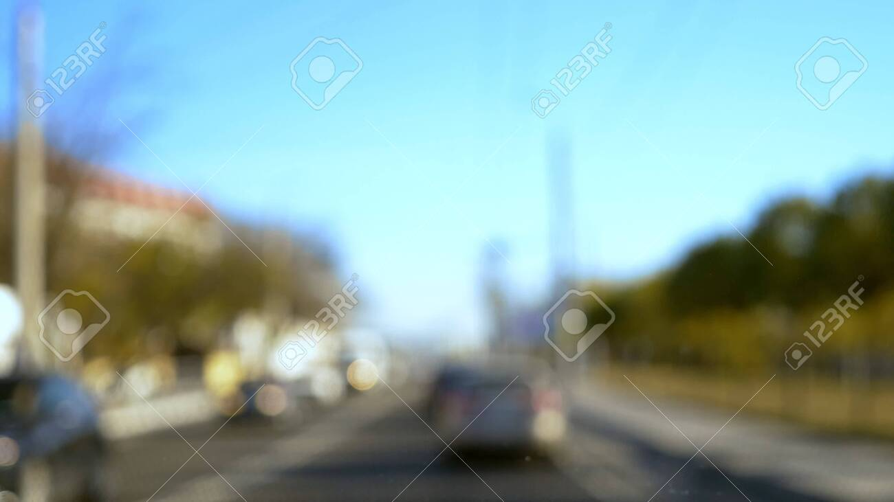 blurred background. Cars drive along the highway on a city bypass on a clear summer day. copy space. blue sky - 133778953