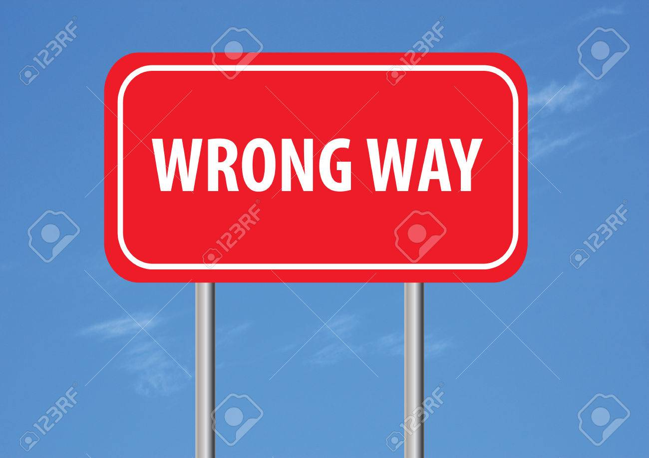 wrong way sign with sky in the background stock photo picture and